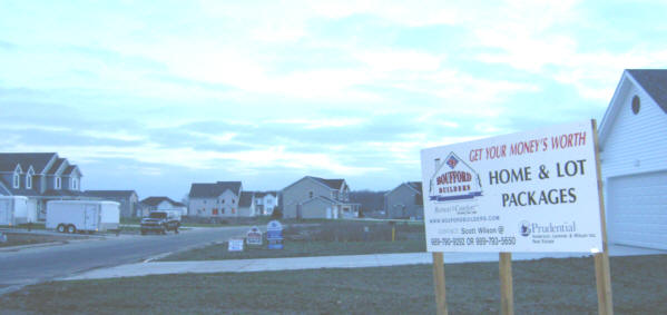 New homes sprout in Briar Farms and Rueger Farms on Midland Road between Three and Four Mile Roads, a huge subdivision projected to have up to 300 homes.